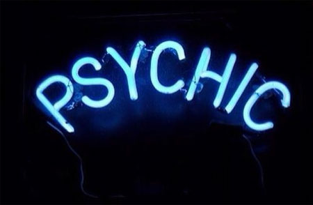 Picture of a blue neon on sign saying Psychic